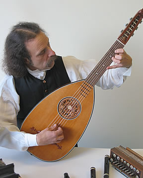 Walter Buckingham Musician plays a variety of historical musical instruments including the lute guitar.
